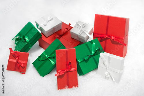Gift boxes isolated on white background in snow.