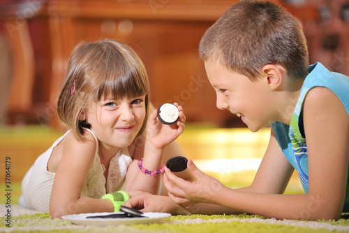 boy  and girl playing with cookies