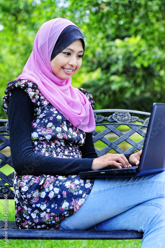 A Young Muslim Women with a laptop