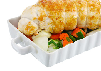 Crop of  grilled turkey breast with  vegetables on baking pan