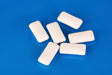 Chewing gums on blue background