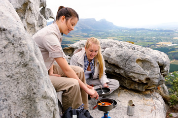 mountain hikers cook food
