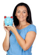 Adorable woman with a blue money-box