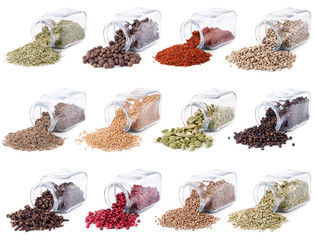 Spices and herbs are scattered on a white background