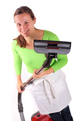 Young woman with vacuum cleaner in hands