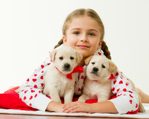 Best friends - portrait of  girl with cute puppies
