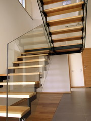 Modern glass, metal and wooden staircase