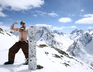 Snowboarder in mountains of the Caucasus