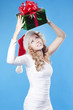 Pretty Santa girl with a present gift for New Year or Christmas