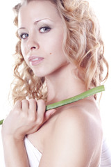 Beautiful blond young woman with aloe