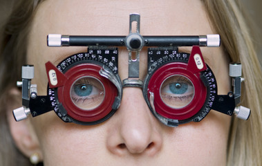 Eye examination with blue eye girl.
