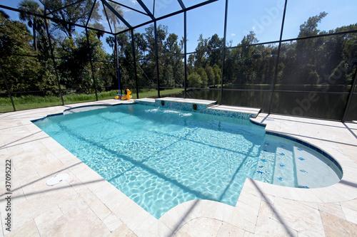 Leinwanddruck Bild Swimming Pool with Lake View