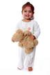 petite fille avec ourson en peluche