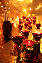 Closeup of red wine and candle lights.