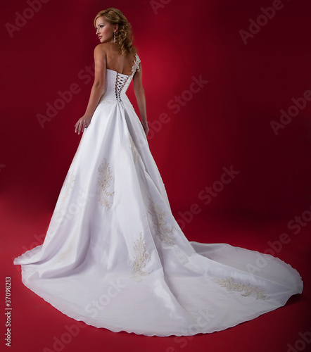 Fiancee in long white bridal  dress