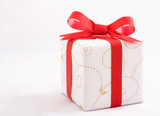 Close up of gift box with red bow isolated on white background