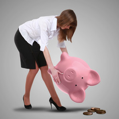 Piggybank and young business man