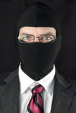 Businessman In Balaclava Looks At Camera