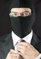 Businessman In Balaclava Adjusts Tie, Close