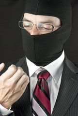 Businessman In Balaclava Inspects Nails
