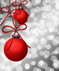 Hanging Ornaments on Blurred Silver Background