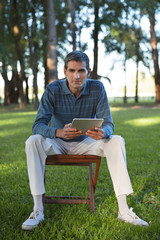 Casual Man Holding Tablet PC
