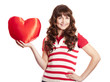 Beautiful brunette girl with toy heart. Photo for st. Valentine