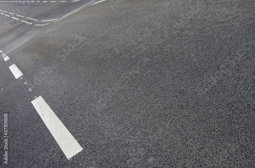 poster of wavy asphalt road with white line pattern