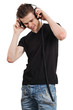Young male listening to headphones