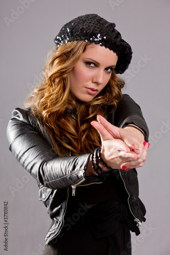Attractive Female Making Gun Gesture with Hand