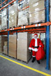 Professional Santa Claus for hire waiting in storehouse