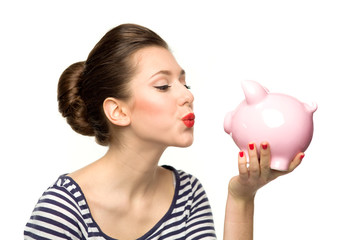 Pin-up girl kissing piggybank