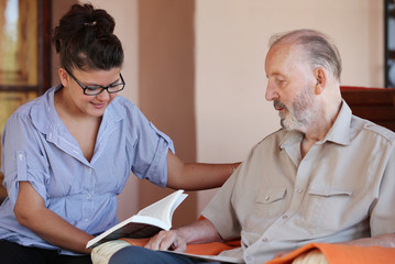 carer reading to senior
