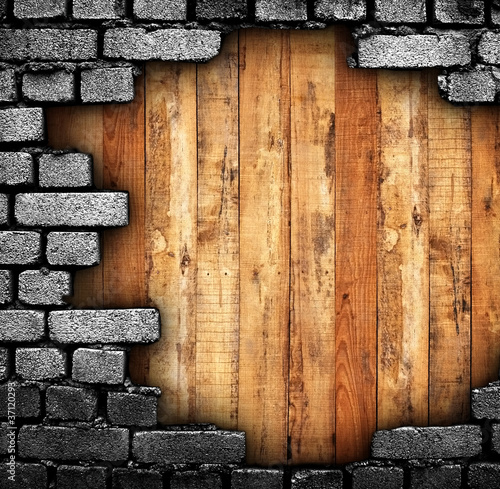 broken wall with wood background