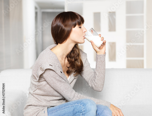 Young woman drinking glass of milk