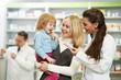 Leinwanddruck Bild - Pharmacy chemist, mother and child in drugstore