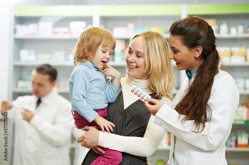 Leinwandbild Motiv Pharmacy chemist, mother and child in drugstore