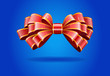 Red bow on a blue background.
