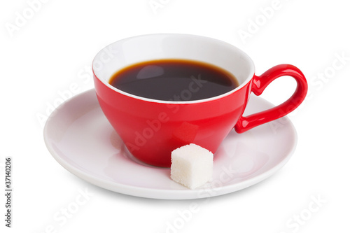 Red cup of coffee and a slice of white sugar on a saucer