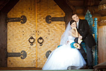 The bride and groom on the backdrop of doors