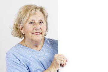 Senior woman holding blank sign