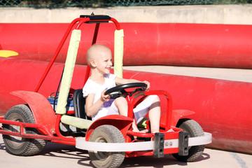 child on go cart