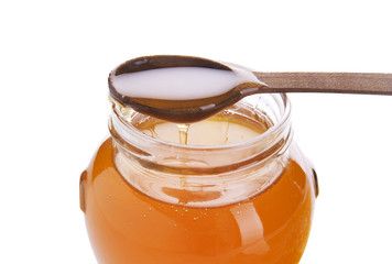 honey in the pot on a white background