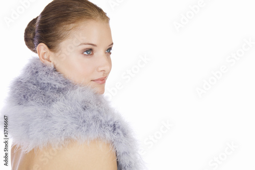 Portrait of a young woman wearing a feather shrug