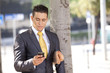 Businessman sending messages in his cellphone