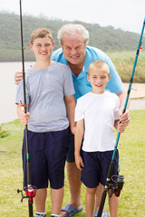 portrait of grandpa and grandsons fishing