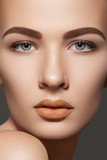 Cosmetics. Clean skin, eyebrows, sexy lips makeup on model face