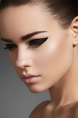 Fashion elegance eyeliner makeup on model eyes