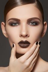 Fashion style, manicure and make-up. Dark lips & nails polish