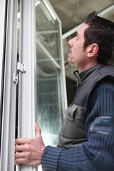 Man fitting windows